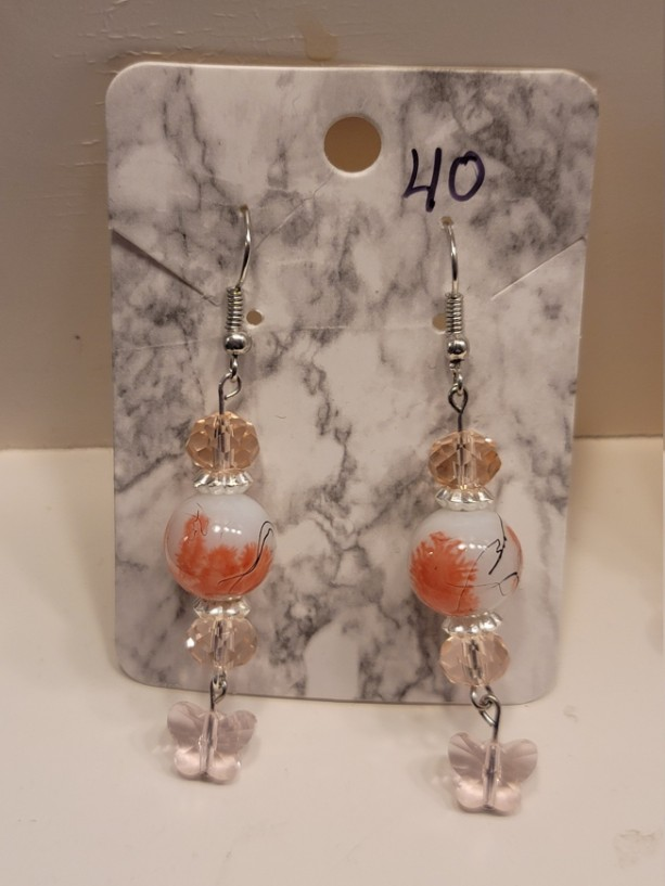 Pink beads with butterfly charm earrings