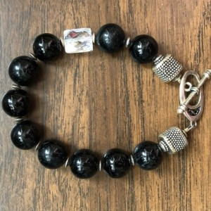 Bracelet with round black onyx beads, cz bead and sterling silver toggle, beads and findings