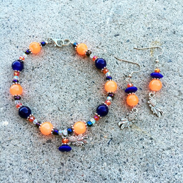 Fluorescent orange, blue/purple and silver-toned coy charm bracelet and earrings
