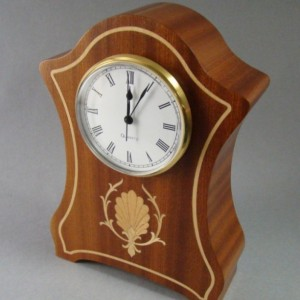 Mantle clock of Ribbon sapele with inlay.