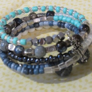 Six layered wrap bracelet with blue and silver beads.