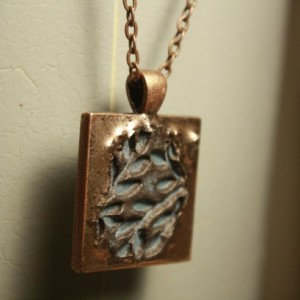 Copper pendant highlighting rustic blue foliage