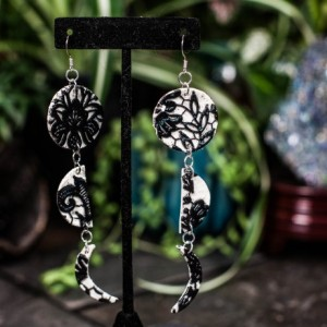 Polymer lace lunar cycle dangly earrings
