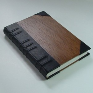 Handmade book bound in leather and wood