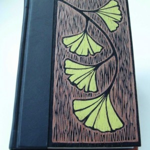 Handmade book, bound in leather and wood, original block-print cover art.