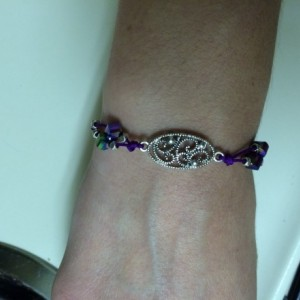 Handmade adjustable bracelet with purple cord and multicolor beads