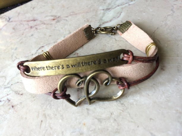 "Beige/ natural leather bracelet with bronze tone plate connector said ""Where there's a will there's a way"" and double heart charm B00243"