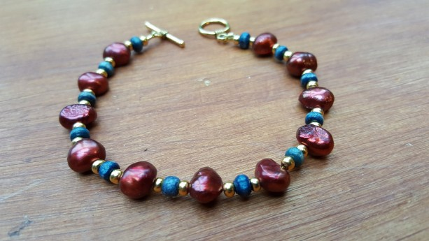 Rich burgundy, gold and navy blue beads bracelet, golden color clasp and wire