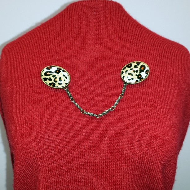 Leopard print cameo and chain sweater keeper