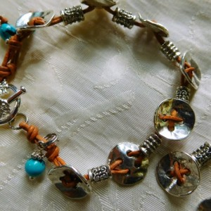 Natural leather and silver tone buttons, silver tone beads bracelet,  and earring matching set design.  #BES00115