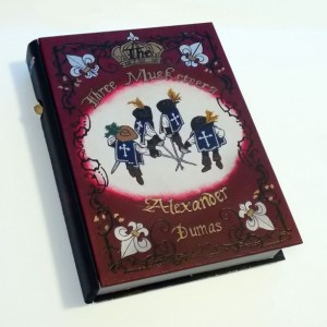 The Three Musketeers hideaway book box.  Beautiful and hand decorated
