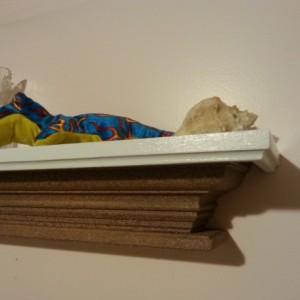 Floating crown molding shelf with stone finish