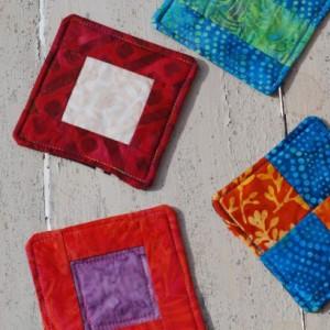 Assorted Batik Coaster Set with Orange, Blue, Red, White, Black, Green, and Purple Designs