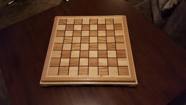 Chessboard made from oak and maple with black walnut inlays