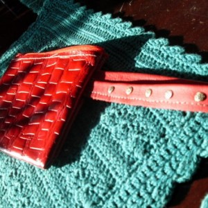 Red leather alligator print clutch purse with 2 inside lamb skin pockets and a wrist strap