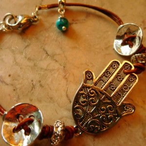 Natural dye Brown leather with Hamsa charm and decorative silver tone buttons.  #B00214