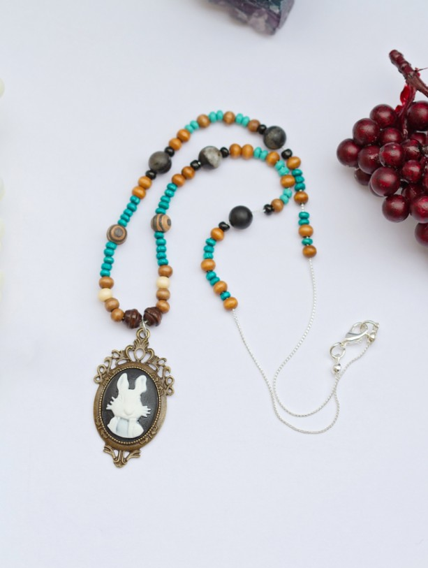 Alice in Wonderland white rabbit pendant with various wood beads and black network stones and black glass seed beads/Under 20 dollars