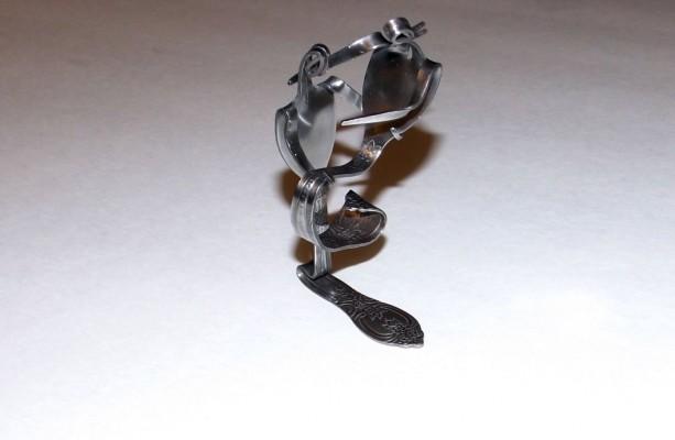 Fork sculpture man carrying woman