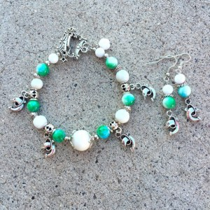 Dolphin charm and marbled glass bracelet with silver charm earrings