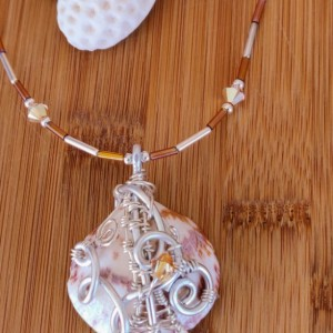 Natural wire wrapped topaz seashell