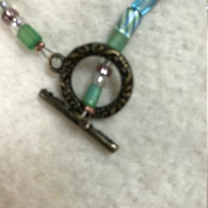 "Sea Monster Dragon's Eye Necklace 22"" long"