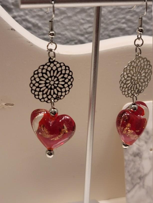 Heart and metalwork earrings