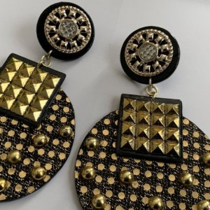 Gold and black studded earrings