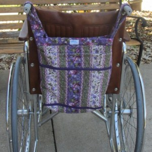 Wheel Chair Bag, in purple floral, with 2 outside pockets, loops to go over chair handles