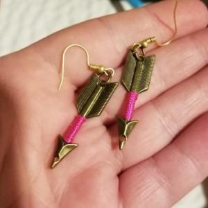 Gold arrow hook earrings with pink around arrow