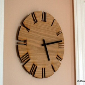 "Unique Roman Style Wood Wall Clock. Cutout White Oak clock, modern Roman style. 15"" diameter."