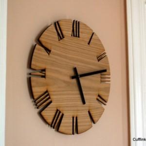 "Unique Roman Style Wood Wall Clock. Cutout White Oak clock, modern Roman style. 15"" diameter."