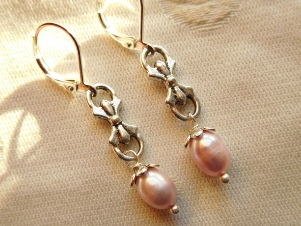 Earrings made with Pink freshwater pearls, silver tone laze connector with silvertone lever back earrings.#E00294
