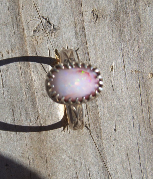 Hadcrafted sterling silver ring set with a natural white opal. Ring was crafted, stone polished and set in the 1980's.