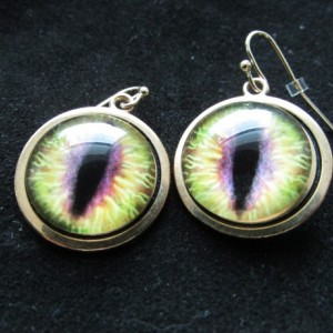 Light green Dragon eye ear rings.