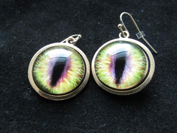 Light green Dragon eye ear rings.