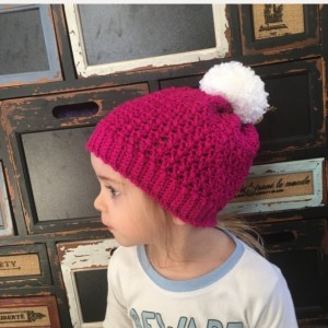 Hot pink sparkle beanie hat with white pom pom