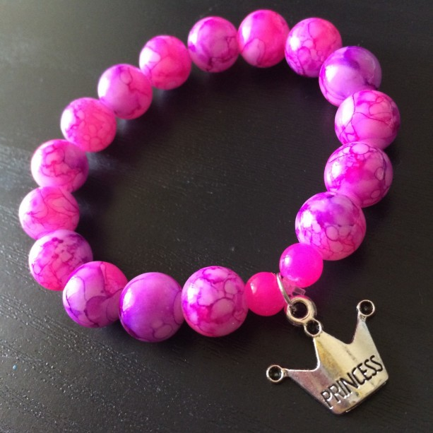 Stretch bracelet, silver princess crown charm, pink and purple