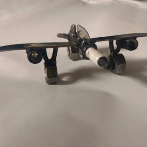 Upcycled sparkplug jet plane