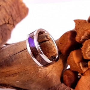 size 4 stainless steel and pinecone ring, stainless steel core and edge trim, pinecone wood, lavender resin. 6mm band