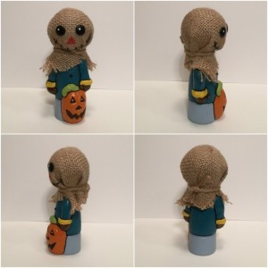 Scarecrow wood and clay figurine