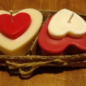 Two 3.5 oz heart-shaped red and white handmade soy wax candles with inset heart on top