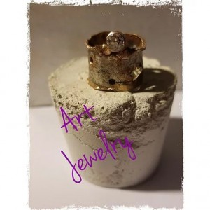 Distressed band ring with White Topaz