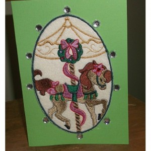 The carosal horse is a embroidered card. Pat embroidered the carosal horse on a piece of felt and glued to cardstock. A border of beads.