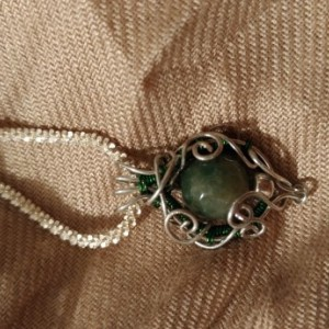 Silver and green glass filigree pendant