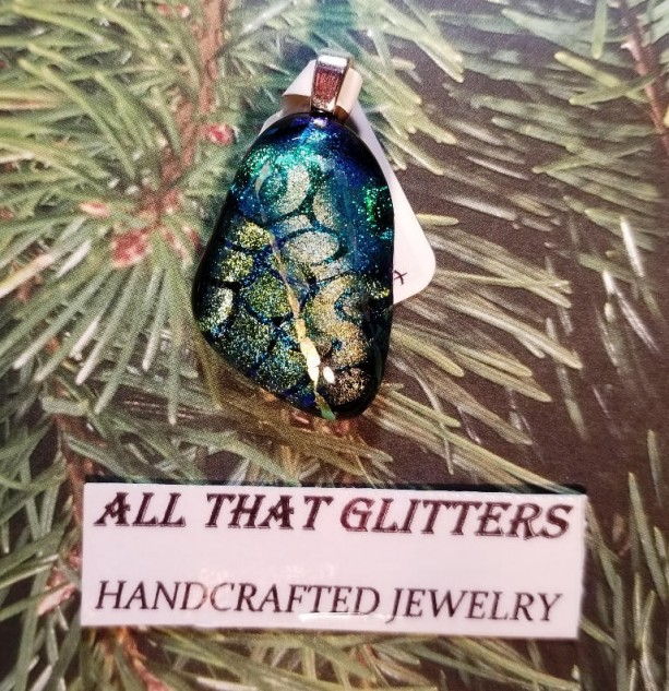 Dichroic Glass Pendent. Gold and teal on a black background with a sterling silver finding. Great for choker or chain. Wonderful gift idea.