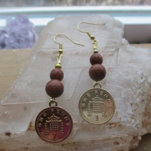 Gold tone Penny Earrings.