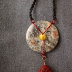 Fishing in the Oriental sea:  This necklace has a delicate bird bone, a carved Chinese bead, a shell fish and a donut (pi) stone...