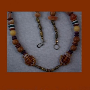 Fishing for agate:  Ingredients are an agate focal stone, beads of all sorts and a few fish.
