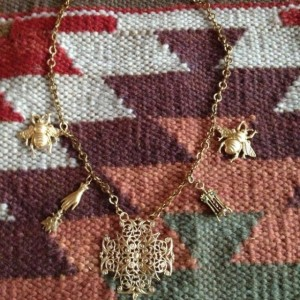Gold finished brass charm necklace that makes a statement.
