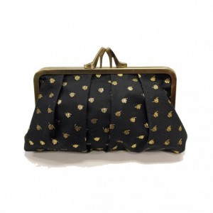 black & gold dot heel clutch